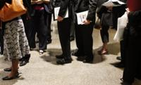 AP - In this Sept. 10, 2009 photo, job hunters wait in line to meet with recruiters at a job ...