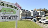 AP - In this photo made Oct. 26, 2009, a new development of townhouses is seen in Wakefield, Mass. Sales ...