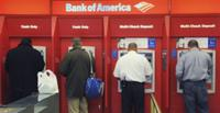 AP - FILE - In this Oct. 16, 2009 file photo, customers use ATMs at a Bank of America branch ...
