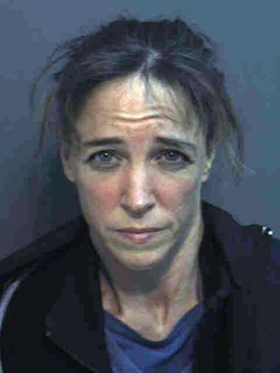 This photo released by the Orange County, Florida jail shows Lisa Marie Nowak, an astronaut who was a mission specialist on a Space Shuttle Discovery flight in 2006. Nowak was arrested February 5, 2006 in Orlando after allegedly driving more than 12 hours from Texas to confront a younger woman who had been dating a fellow astronaut Nowak was also involved with.  (Orange County Jail via Getty Images)