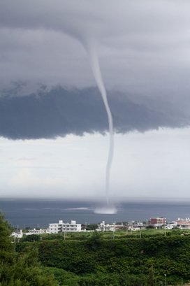 A 'waterspout,' described as a tornado over water, ...