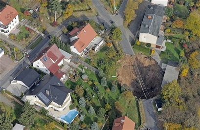 An aerial view shows a giant landslide under ...