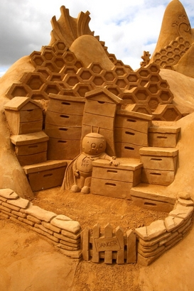 "A sand sculpture entitled ""The Hive"" carved by ..."