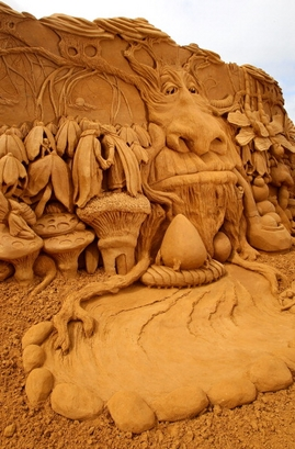 "A sand sculpture entitled ""Enchanted Garden"" ..."