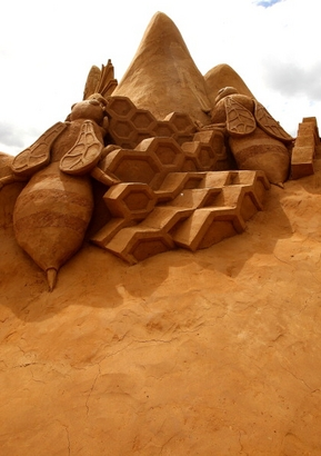 "A sand sculpture called ""The Hive"" carved by ..."