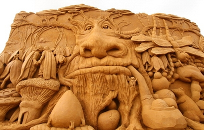 "A sand sculpture called ""Enchanted Garden"" carved ..."