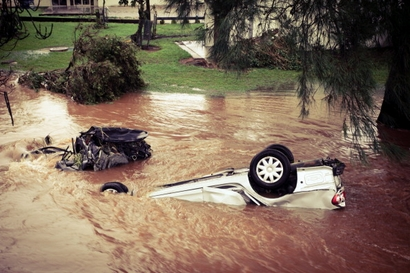 Debris and an overturned car are seen in central ...