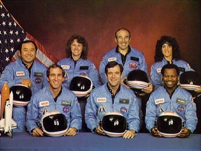 Space Shuttle Challenger crew members gather ...