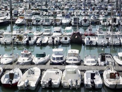 'Love Love' is shown alongside boats in a harbor.