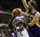 Milwaukee Bucks ' Corey Maggette (5) is fouled as he goes up for a shot against Los Angeles Lakers ' Pau Gasol (16) and Matt Barnes during the second half of an NBA basketball game Tuesday, Nov. 16, 2010, in Milwaukee. The Lakers won 118-107.