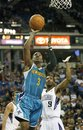 New Orleans Hornets guard Chris Paul , left, drives to the basket past Sacramento Kings defender Luther Head during the first half of an NBA basketball game, Sunday, Nov. 21, 2010, in Sacramento, Calif.