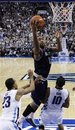 Georgetown's Austin Freeman, center, goes up for a shot between Villanova's Dominic Cheek, left, and Corey Fisher in the second half of an NCAA college basketball game, Saturday, Jan. 29, 2011, in Philadelphia. Georgetown won 69-66.
