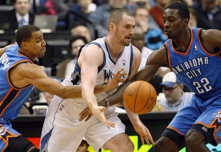 Minnesota Timberwolves Forward Kevin Love, Center, Passes To A Teammate Under Pressure From Oklahoma City Thunder