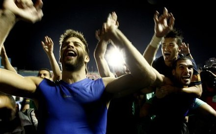 Barcelona Player Gerard Pique, Left, Celebrates