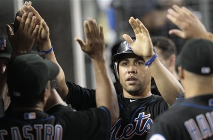 New York Mets' Carlos Beltran, Middle, Celebrates