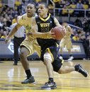 West Virginia 's Joe Mazzulla drives by South Florida 's LaVonte Dority Sunday, Jan. 23, 2011, during the second half of an NCAA basketball game in Morgantown, W.Va. West Virginia 56-46.