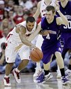 Wisconsin's Jordan Taylor and Northwestern's Alex Marcotullio vie for a loose ball during the first half of an NCAA college basketball game Sunday, Feb. 27, 2011, in Madison, Wis.