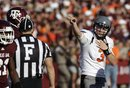 Oklahoma State quarterback Brandon Weeden (3) signals a first down after a penalty call against Texas A&M during the fourth quarter of an NCAA college football game Saturday, Sept. 24, 2011, in College Station, Texas. Oklahoma State beat Texas A&M 30-29.
