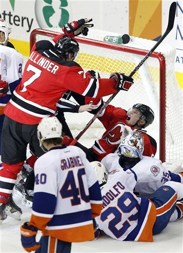 New Jersey Devils' Zach Parise, Top Right, Reacts