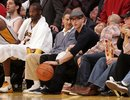 Justin Timberlake dribbles a basketball near the Los Angeles Lakers ' bench and Kobe Bryant , left, during a basketball game against the Portland Trail Blazers  in Los Angeles, on Sunday, Nov. 7, 2010.