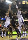 Indiana Pacers forward Solomon Jones , center, goes up for the shot between Sacramento Kings ' Francisco Garcia , left and Jason Thompson during the first quarter of an NBA basketball game in Sacramento, Calif., Tuesday, Nov. 30, 2010.