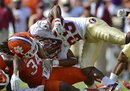 Florida State running back Chris Thompson (23) is tackled by Clemson linebacker Quandon Christian (34) during an NCAA college football game, Saturday Sept. 24, 2011 at Memorial Stadium in Clemson, S.C. Clemson won 35-30.