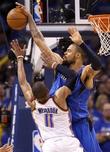 Dallas Mavericks Center Tyson Chandler, Right, Blocks