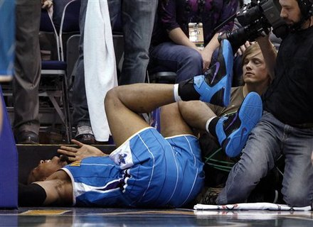 New Orleans Hornets forward David West (30) lies on the baseline after being injured during the second half of an NBA basketball game against the Utah Jazz on Thursday, March 24, 2011, in Salt Lake City. West was taken off the court in a wheelchair. The Hornets won 121-117.