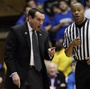 Duke coach Mike Krzyzewski speaks with an official during the first half of an NCAA college basketball game against Temple in Durham, N.C., Wednesday, Feb. 23, 2011. Duke won 78-61.