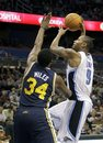 Orlando Magic power forward Rashard Lewis (9) takes a shot over Utah Jazz small forward C.J. Miles (34) during the first half of an NBA basketball game in Orlando, Fla., Wednesday, Nov. 10, 2010. Utah won 104-94.