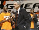 Former Oklahoma State coach Eddie Sutton, center, talks to fans during a ceremony marking Thursday's 10th anniversary of the death of 10 members of the Oklahoma State basketball program in a plane crash, at halftime of an NCAA college basketball game between Oklahoma State and Texas in Stillwater, Okla., Wednesday, Jan. 26, 2011.