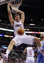 Los Angeles Clippers &#39; Blake Griffin dunks the ball as Denver Nuggets &#39; Shelden Williams looks on during second half of their NBA preseason basketball game, Thursday, Oct. 14, 2010, in Los Angeles.