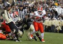Purdue cornerback Normondo Harris , left, flips over as he dives for Illinois running back Jason Ford during the first half of an NCAA college football game in West Lafayette, Ind., Saturday, Oct. 22, 2011.