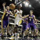 Indiana Pacers center Roy Hibbert (55) and Los Angeles Lakers guard Steve Blake (5) and forward Luke Walton (4) battle for a loose ball during the fourth quarter of an NBA basketball game in Indianapolis, Wednesday, Dec. 15, 2010. Los Angeles won 109-94.