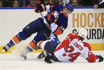 New York Islanders' Josh Bailey, Left, And Florida Panthers' Ryan Carter, Right, Collide