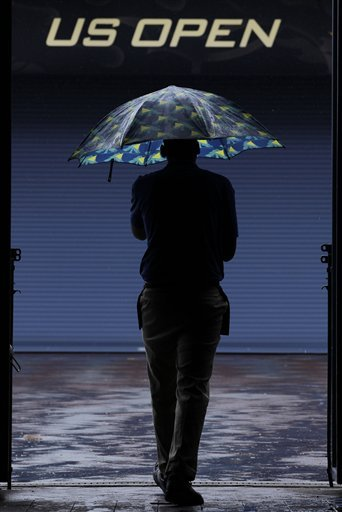 A Man With An Umbrella Arrives