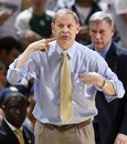Michigan coach John Beilein gives instructions during the second half of an NCAA college basketball game against Michigan State , Thursday, Jan. 27, 2011, in East Lansing, Mich. Michigan won 61-57.