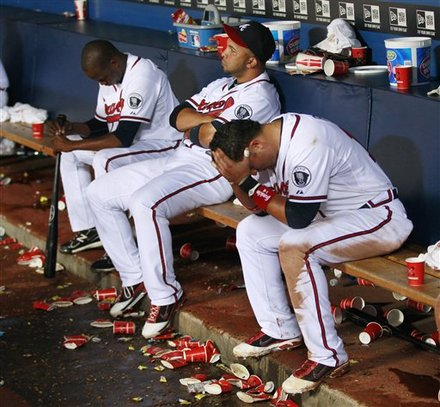 Atlanta Braves, From Left, Cristhian Martinez, Alex Gonzalez And Martin Pardo Sit On The Bench