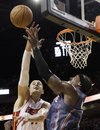Miami Heat center Zydrunas Ilgauskas , left, of Lithuania, fights for a rebound with Charlotte Bobcats small forward Gerald Wallace (3) during the second quarter during an NBA basketball game in Miami, Friday, Nov. 19, 2010.