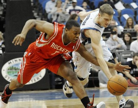 Minnesota Timberwolves' Luke Ridnour, Right, And Houston Rockets' Kyle Lowry  Battle For A Loose Ball In The First Half