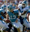 FILE-This April 10, 2010 file photo shows North Carolina 's Michael McAdoo (94) sacking quarterback T. J. Yates during the second quarter of the annual Tar Heel Blue White spring football game at Kenan Stadium Chapel Hill, N.C. A former North Carolina football player has filed a lawsuit against the school and the NCAA, seeking reinstatement after being declared permanently ineligible for academic misconduct. McAdoo is also seeking unspecified damages from the school and the NCAA, which the lawsuit accuses of