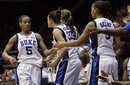Duke's Jasmine Thomas (5) is congratulated by teammates as she leaves the game against Virginia Tech late in the second half of an NCAA women's college basketball game in Durham, N.C., Sunday, Feb. 20, 2011. Duke won 90-40. Thomas scored 27 points in the win.
