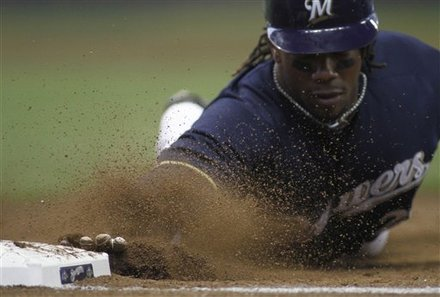 ** CORRECTS MONTH **Milwaukee Brewers' Rickie Weeks Dives