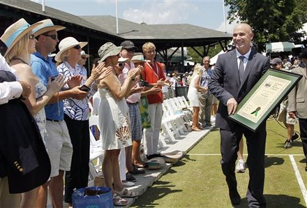 Tennis Great Andre Agassi Walks