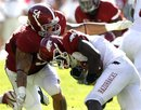 Arkansas running back Ronnie Wingo Jr., right, is stopped by Alabama defensive lineman Jesse Williams (54) in the first half of an NCAA college football game on Saturday, Sept. 24, 2011 in Tuscaloosa, Ala.