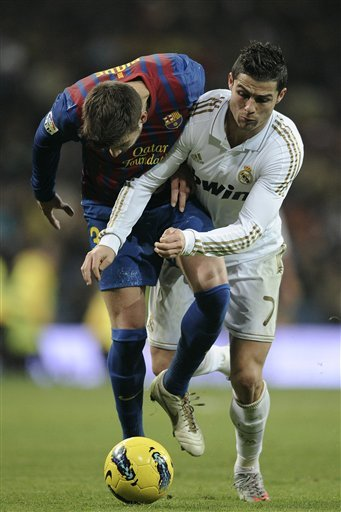 Real Madrid's Cristiano Ronaldo From Portugal, Right, Duels