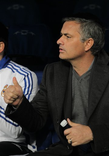 Real Madrid's coach Jose Mourinho from Portugal reacts during a Round of 16, 2nd leg Champions league soccer match against Lyon at the Santiago Bernabeu stadium in Madrid Wednesday March 16, 2010.