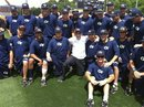 In a photo provided by Georgia Tech, Charlie Sheen, in white, poses for photos with members of the Georgia Tech baseball team Thursday, April 21, 2011, in Atlanta. The actors stopped by the team's practice before his show in Atlanta. The former