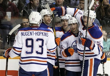Edmonton Oilers Right Wing Jordan Eberle (14) Celebrates With Teammates, Including Ryan Nugent-Hopkins (93) And