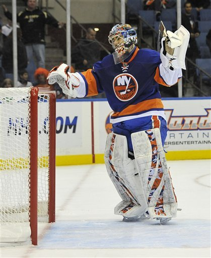 New York Islanders Goalie Rick DiPietro (39) Reacts To Atlanta Thrashers' Alexander Burmistrov's Goal That Put The